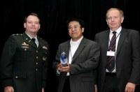 AJ Deng accepting CBD Award